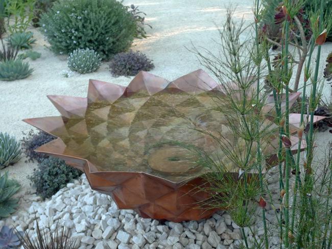 Copper water bowl in Nick Bailey's garden for Winton Capital, RHS Chelsea Flower Show 2016